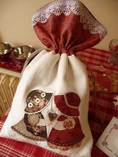 Drawstring bag with country applique.