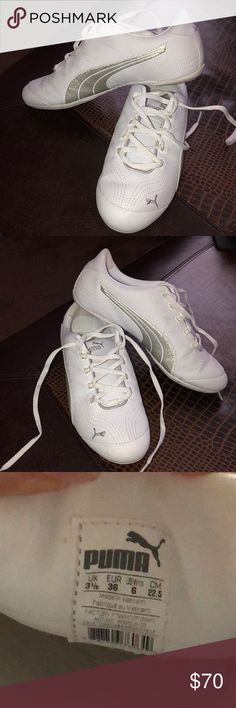 White Puma sneakers - Like New! Bought these without trying them on & they didn't fit 😣. Sadly they fit more like a 6.5 (or maybe a small 7) and are too big for me.  (These say they are a size 6-but my heels slip out & I'm a true 6). The inside soles have support cushion for your heel and arch see 4th picture.  These were worn a few times as fashion sneakers gently.  Small mark on left inside (see last picture) Puma Shoes Sneakers