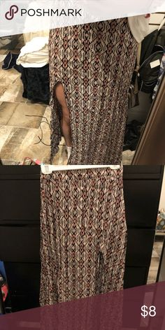Brandy Melville maxi skirt Brandy Melville patterned maxi skirt with high slit. Small tear that is fixable in the back. Brandy Melville Skirts Maxi