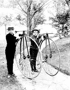 Young boys with high wheel bicycles, 1900