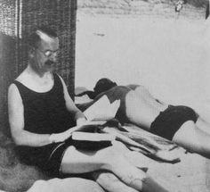 Thomas Mann, reading on the beach. In the shade.