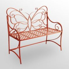 I love this whimsical garden bench. It's made of iron with an orange-red finish. I placed it in my container garden where it is a nice contrast with the gray of the paving and the many colors of the plants in the pots. It needs a bold background to bring out the design