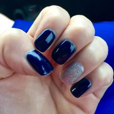 Navy blue nails with silver glitter accent nail.