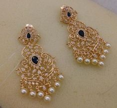 Visit the post for more. Indian Jewelry Earrings, Gold Jhumka Earrings, Jewelry Design Earrings, Gold Earrings Designs, Gold Jewellery Design, India Jewelry, Jewelery, Fancy Jewellery, Pearl Necklaces