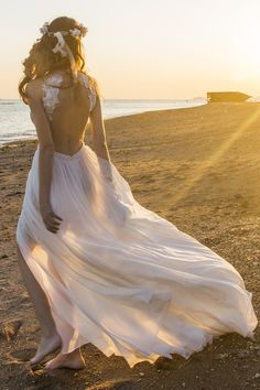 The back of this gown is as breath taking as the front #beachbride #chicnostalgia