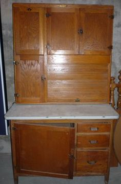 Instead of putting in 4 feet of upper and lower cabinets!  How about this for across from the stove.  $400  Called a Hoosier Cabinet. Counter is enameled steel, like a bathtub.  Good for food prep.