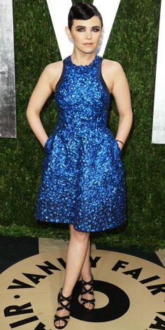 At the VF Oscars party, Goodwin sparkled in an oceanic Monique Lhuillier cocktail dress that she styled with strappy Jimmy Choo sandals.