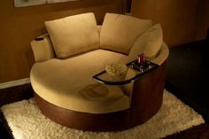 The Cuddle Couch. This site has amazing customizable theatre chairs.