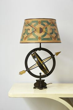 """Lamp """"Astrobale"""" by Gilbert Poillerat & André Arbus / Console """"JMF"""" by Karl Springer"""