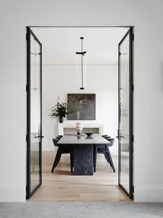 Source: Robson Rak Simple and elegant. Black marble paired with a Michael Anastassiades Tube Chandelier. Definitely a dining table I'd like to sit at.