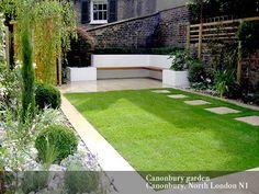 Small garden designs. Like the seating idea in the corner.
