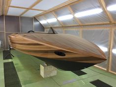 K-625 Torpedo Russian built wooden speedboat that is kept in a sumptuously luxuriant storage facility its rich owner helped design it and now is desperate to preserve the wood as a useful art form / fun recreation prised possession ❤️