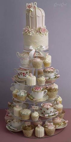 "English Tea Party Cake + Cupcake combo, I like this idea of taking all sorts of little cakes for the tea party baby shower idea. It fits in with the ""Mad Hatter"" theme I am going for.. just not those colors..so cute!"