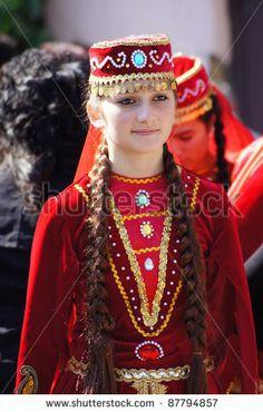 TBILISI, GEORGIA - OCTOBER 9: Participant of Georgian Folk Autumn Festival - Tbilisoba, in azerbaijan traditional costume dancing Asma Kasma dance, October 9, 2011 in Tbilisi, Georgia. by Anna Bogush, via ShutterStock