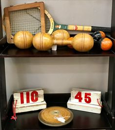 Vintage Sporting Goods   1930's Wooden Discus  Vintage Yard Markers For Shot Put or Javelin Throw  1920's Barbells  Football Helmet and Pads  Ice Skates  Catchers Mask   Tennis Rackets  More!  Dealer #672  Forestwood Antique Mall  5333 Forest Ln Dallas, TX, 75244