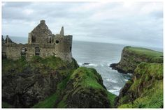 Dunluce Castle: Medieval ruins perched on the cliff of Northern Ireland's coast