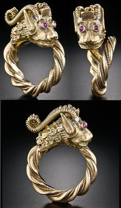 Vintage gold and ruby dragon ring in 18 k gold.