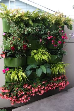 We love this inspiring living wall, created with Living Wall Planters in Green! These planters are simple to install and keep plants thriving  | Urbilis.com | http://www.urbilis.com/living-wall-planter/