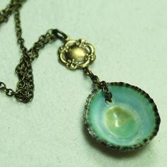 Hey, I found this really awesome Etsy listing at http://www.etsy.com/listing/50229863/green-limpet-shell-and-bronze-necklace