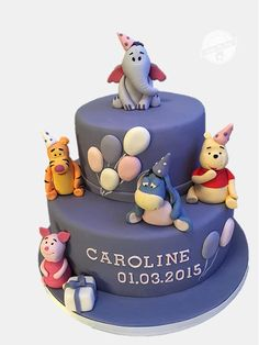 Winnie the Pooh purple tiered party cake with tigger eeyore piglet and heffalump.