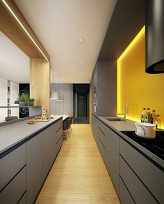 Un mur jaune lumineux dans cette cuisine très moderne