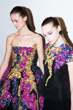 Oscar de la Renta Fall 2017 Rainbow Eye Makeup Beauty Look: Joie de vivre, or the enjoyment of life, was the theme behind Oscar de la Renta's fall 2017 beauty.--- Floral beaded strapless gown and beaded top. | Coveteur.com