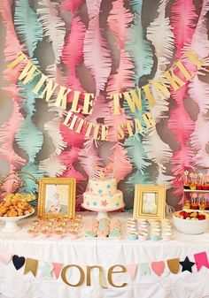"This ""Twinkle Twinkle Little Star"" first birthday party is a fabulous way to celebrate your baby turning 1 year old. With pink, coral, and mint decoration ideas, this beautiful birthday bash is every little girl's dream! #babyshowerdecorations"