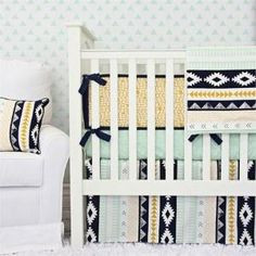 Make your nursery unforgettable with the stylishly over-the-top Aztec Gold and Mint Crib Bedding Set from Caden Lane. This fabulous bumper-less crib bedding set coordinates with all the pieces in the Aztec Gold and Mint baby bedding collection, so you can mix and match crib bedding separates and accessories to create your ideal nursery bedding collection by wteresa