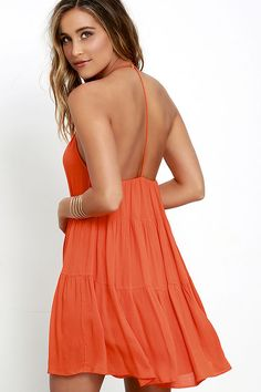 Admirers will flock from far and wide to catch sight of you in the Such a Tease Coral Orange Halter Dress! Woven rayon falls from a high halter neckline (with hook clasp closure), into a tiered, trapeze silhouette. A T-strap accents the open back for chic, minimalist look.