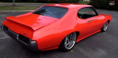 Brutal 1969 Pontiac GTO Judge Tribute. In this Hot Cars video you will see a phenomenal custom built muscle car by Indy Street Rods & Classics and named