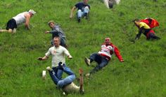 Every year in Glouster, England locals and tourists alike gather together and roll a 9-pound round of Double Gloucester cheese off Cooper's Hill during the Spring Bank Holiday and chase it in one bizarre race!