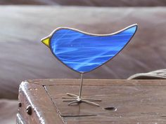 This handmade, one of a kind blue stained glass chick is a fun way to add some blue color to your decorating ideas. Ive created this little free-standing glass bird suncatcher with a piece of beautiful transparent medium blue wispy opalescent stained glass. Tiffanys method for doing
