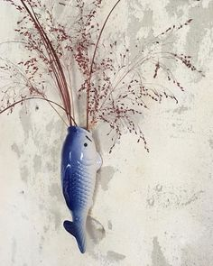 Koi fish wall vase for dried flowers.