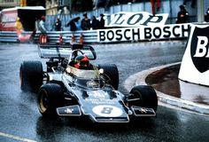 Emerson Fittipaldi, taking a corner in the rain during the 1972 Monaco Grand Prix in his Lotus 72D.