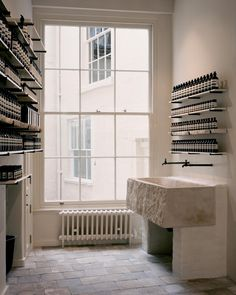 Aesop renovates Georgian townhouse in Bath, unveiling hidden staircase and library