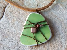 Wire Wrapped Pottery Shard Recycled by UniqueChiqueJewelry on Etsy
