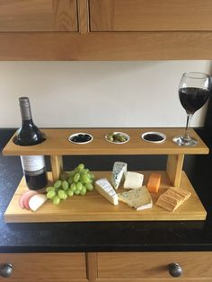 Cheese and wine board, sharing board, tapas board, wine, christmas gift, wedding present, solid wood, solid wood cheese and wine rack, by SMhomemadejoinery on Etsy https://www.etsy.com/uk/listing/543352532/cheese-and-wine-board-sharing-board