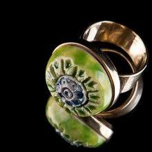 brass ring with a green ceramic eye.  www.katesakis.lt