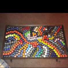 coffee table design out of beer bottle caps!