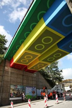 Street artist Megx converted a bridge in Wuppertal, Germany into a giant Lego structure using colored panels that create the illusion of being the underside of Lego bricks. The bridge itself is part of an old train line that has been converted to a pedestrian and cycle path.