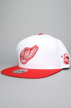 3fbb852262a The Detroit Red Wings Wool Snapback Hat in White   Red Send your street  style through a time warp in this NHL Vintage Collection snapback hat by  Mitchell ...