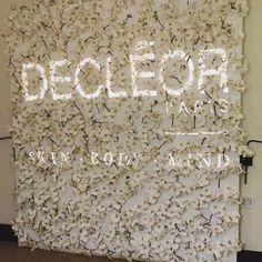 Wall of orchids as background for projections at Decléor beauty event in #NewYork. Great inspiration for floral and branding.