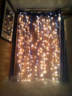Cheap easy DIY headboard idea   - christmas lights   - shear curtain