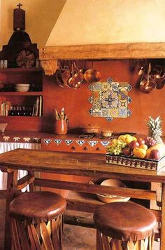 mexican style kitchen with earthy reds, terracotta floor, other decorative tile. So cozy to work in and just hang out in, too.