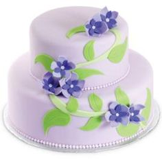 Violets on the Vine Cake. A bouquet of pretty posies winds its way up two fondant-covered tiers.