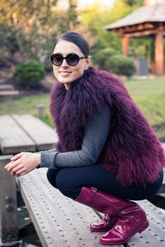 Inside Huggle App Founder Valerie Stark's London Closet: Valerie Stark's closet has one of the biggest CHANEL collections we've ever seen. In collaboration with Huggle. -- Burgundy fur vest and circle sunglasses     coveteur.com