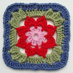 Ravelry: Granny Square with a Flower - free pattern by Jolanta Gustafsson
