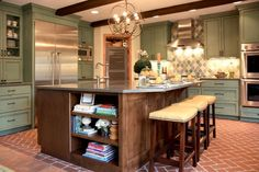 The kitchen design experts at HGTV.com share photos of a beautiful, rustic green kitchen designed by Bria Hammel.