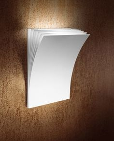 Axo Light: Polia LED small wall lamp: This lovely and unique wall lamp comes in a variety of colors, working in any space. It's modern, textured design would look beautiful in the living room, office, or bedroom.
