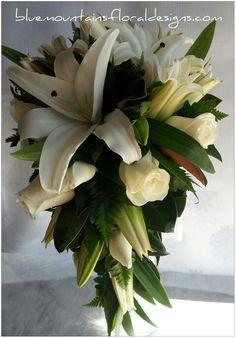 Designer teardrop bouquet# White wedding flowers# classic bridal bouquet# Elegant wedding flowers. www.bluemountainsfloraldesigns.com